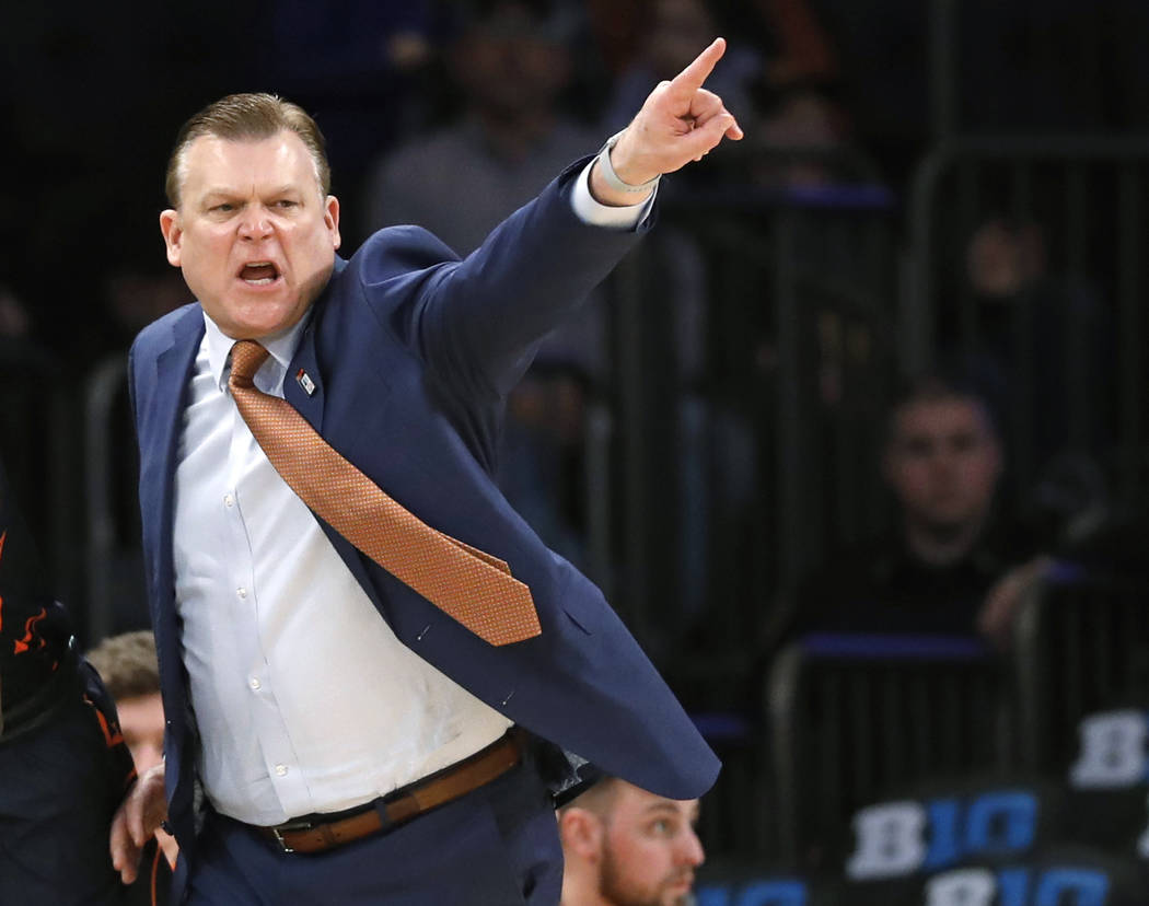 Illinois coach Brad Underwood gestures during the second half of the team's NCAA college basketball game against Iowa in the first round of the Big Ten men's tournament Wednesday, Feb. 28, 2018, i ...