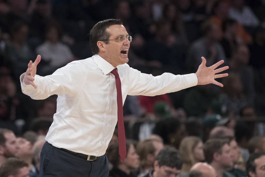 Nebraska head coach Tim Miles gestures during the first half of an NCAA college basketball game against Michigan in the quarterfinals of the Big Ten conference tournament, Friday, March 2, 2018, a ...