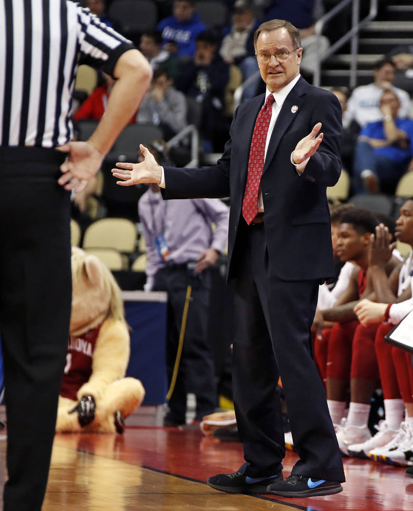 Oklahoma head coach Lon Kruger questions an official during the first half against Rhode Island in the first round of the NCAA men's college basketball tournament in Pittsburgh, Thursday, March 15 ...