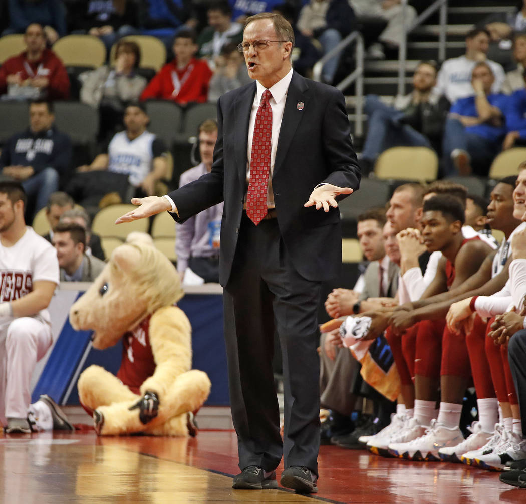 Oklahoma head coach Lon Kruger questions an official during the first half of an NCAA men's college basketball tournament first-round game against Rhode Island, in Pittsburgh, Thursday, March 15, ...