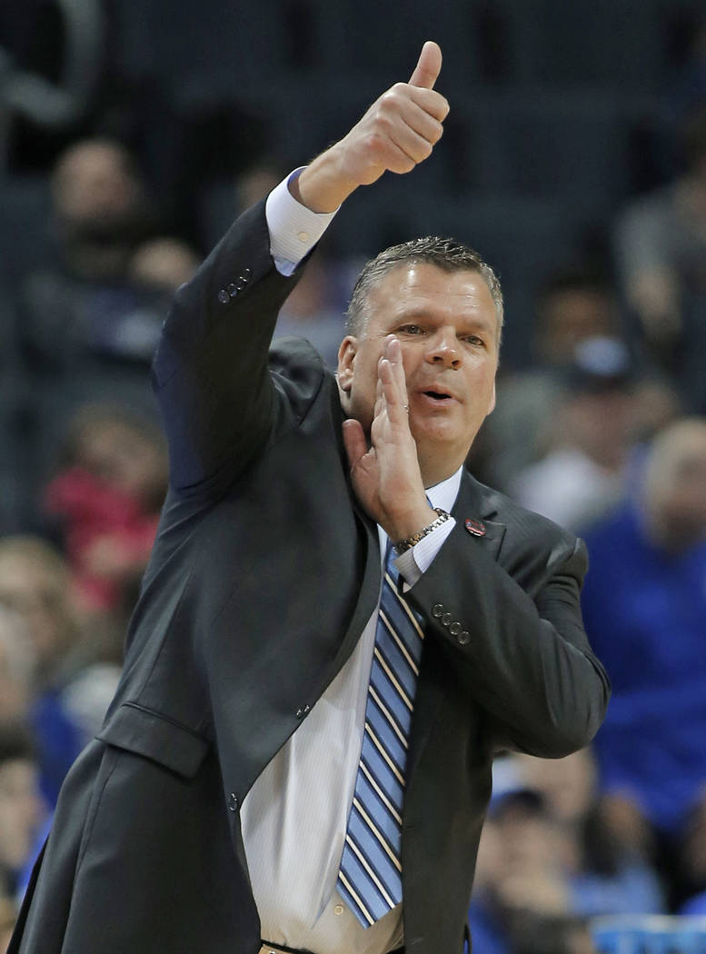 Creighton coach Greg McDermott directs his team against Kansas State during the first half of a first-round game in the NCAA men's college basketball tournament in Charlotte, N.C., Friday, March 1 ...