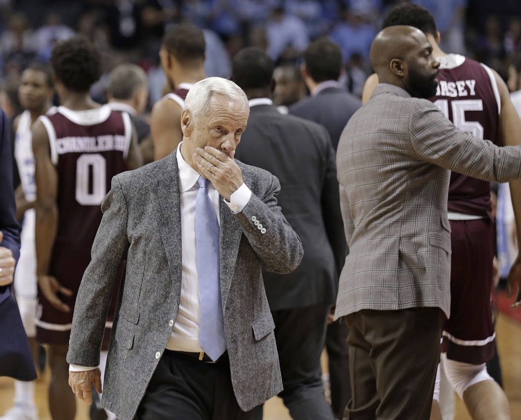North Carolina head coach Roy Williams walks off the court after a second-round game against Texas A&M in the NCAA men's college basketball tournament in Charlotte, N.C., Sunday, March 18, 201 ...
