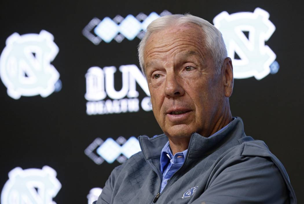North Carolina NCAA college basketball coach Roy Williams speaks with members of the media during a news conference in Chapel Hill, N.C., Tuesday, June 12, 2018. (AP Photo/Gerry Broome)