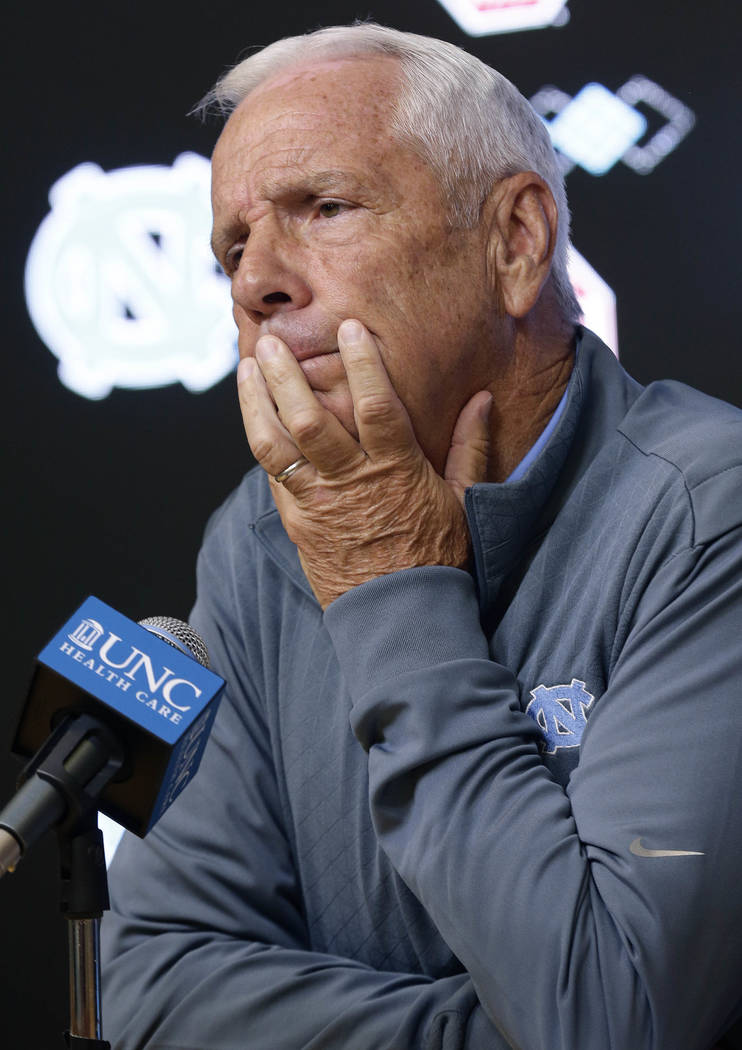 North Carolina NCAA basketball coach Roy Williams takes questions from members of the media during a news conference in Chapel Hill, N.C., Tuesday, June 12, 2018. (AP Photo/Gerry Broome)