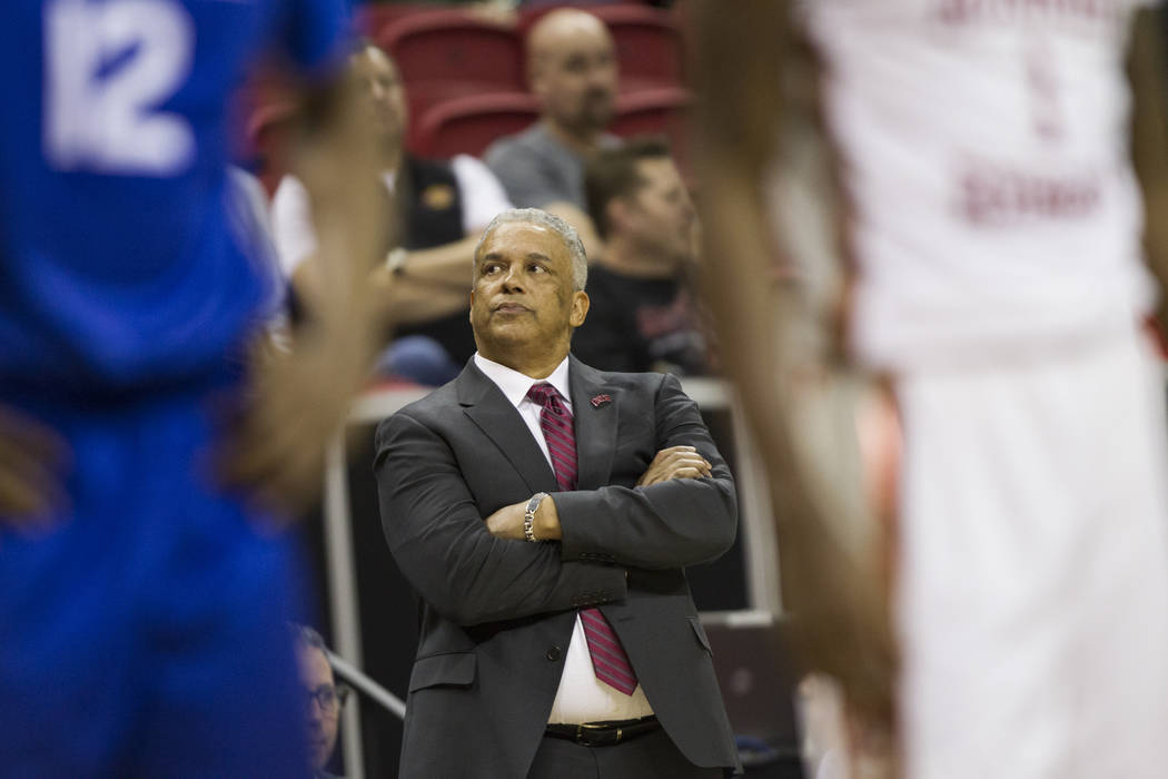 UNLV Rebels head coach Marvin Menzies talks to his team in their game against Air Force Falcons in the second half of the Mountain West Conference men's basketball tournament game at the Thomas &a ...
