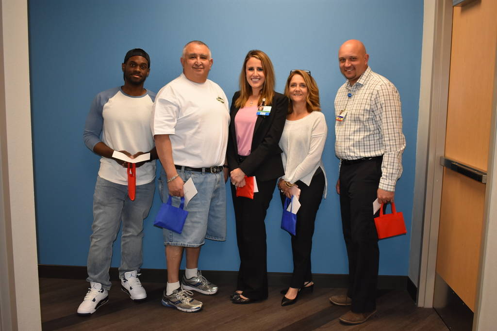 Southern Hills Hospital employees Andrew Brown, left, Brian Abeyta, Alexis Mussi, Kathleen Milhiser and Michael Sanders will be recognized for their efforts during a domestic violence case at this ...