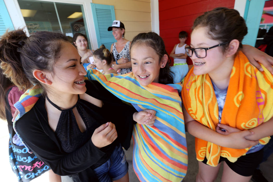 Sisters, from left, Zabraa, 14, Midnight, 10, and London, 13, wait for their brother outside Cowabunga Bay water park in Henderson Wednesday, May 30, 2018. K.M. Cannon Las Vegas Review-Journal @KM ...