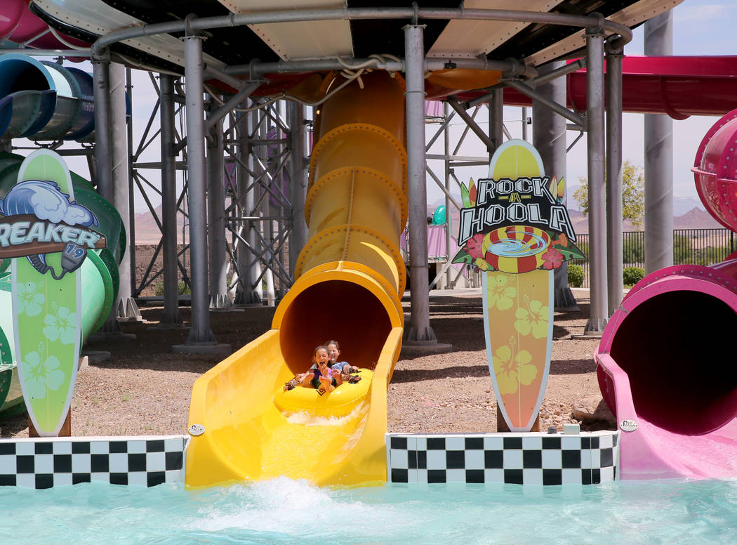 Sisters Midnight, 10, left, and London, 13, ride a water slide at Cowabunga Bay water park in Henderson Wednesday, May 30, 2018. K.M. Cannon Las Vegas Review-Journal @KMCannonPhoto