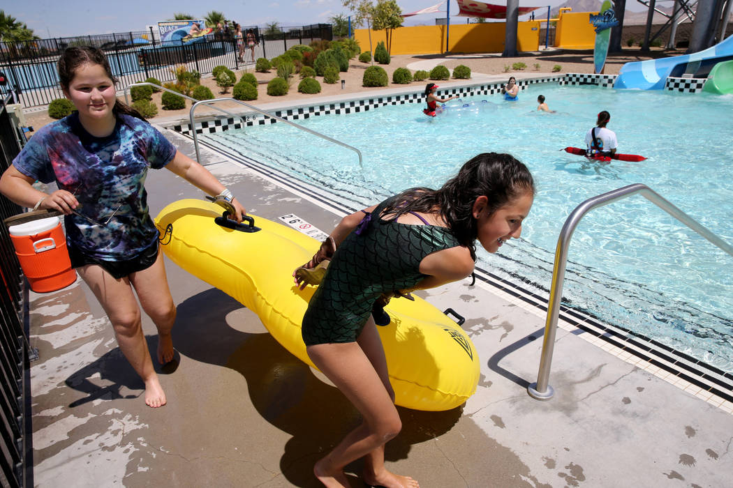 Sisters London, 13, left, and Midnight, 10, walk back to the line after riding a water slide at Cowabunga Bay water park in Henderson Wednesday, May 30, 2018. K.M. Cannon Las Vegas Review-Journal ...