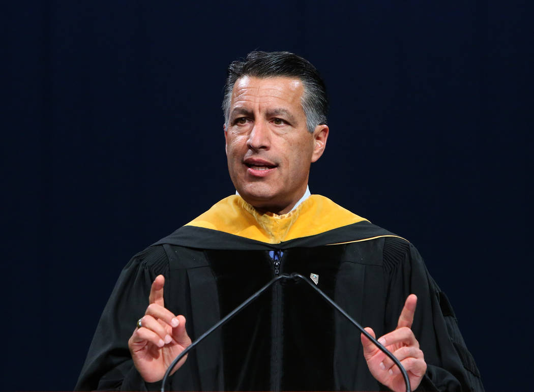Gov. Brian Sandoval delivers remarks during the master's degree graduation ceremony of Western Governors University of Nevada at the Thomas & Mack Center on Saturday, June 2, 2018, ...