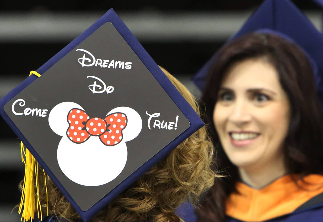 Kristy Geloso, left, and her friend Gisela Riffel, both of Huntington Beach, Calif., chat during the master's degree graduation ceremony of Western Governors University of Nevada at th ...