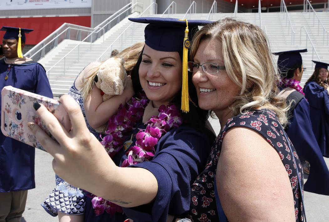 Katarzyna Fennell takes a selfie with her mother Ania Cooper and her daughter Emilee, 5, after receiving her diploma during the master's degree graduation ceremony of Western Governors Unive ...