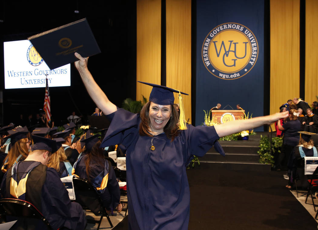 Gayle Freund of Santa Clarita, Calif., reacts after receiving her diploma during the master's degree graduation ceremony of Western Governors University of Nevada at the Thomas & M ...