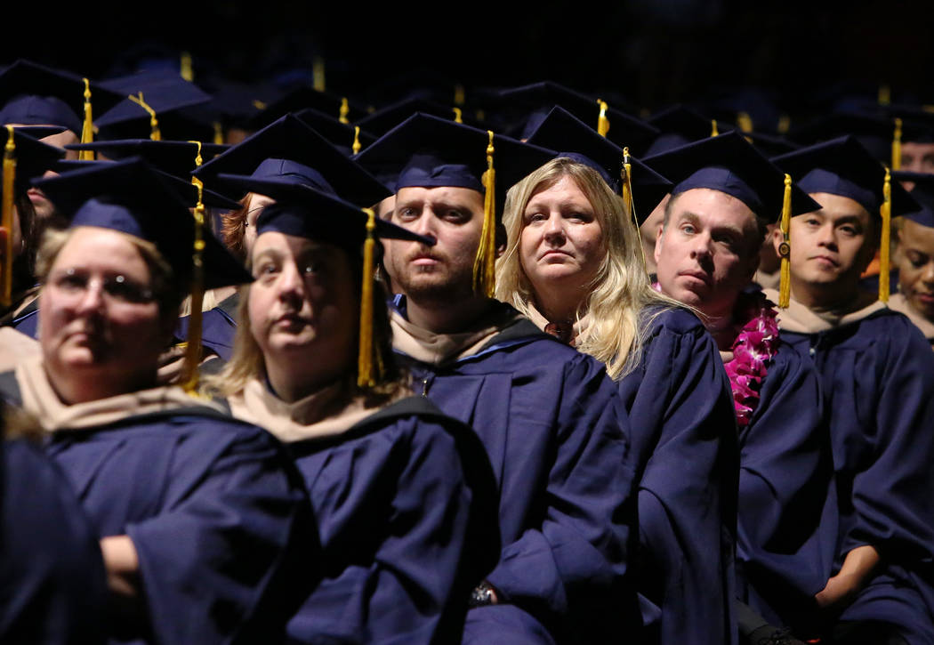 Western Governors University of Nevada students listen as Chancellor of WGU, Dr. Spencer Stewart, not photographed, speaks during the master's degree graduation ceremony at the Thomas & Mack C ...