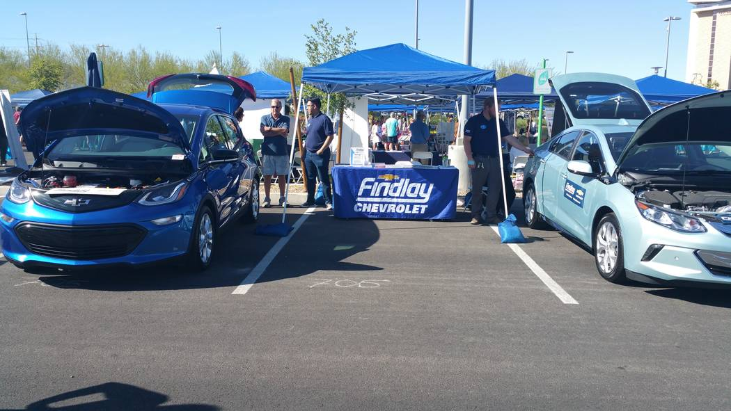 Stan Hanel Findlay Chevrolet exhibited a Chevrolet Bolt EV electric car, left, and a Volt plug-in hybrid electric vehicle, right, during a GreenFest 2018 event at Downtown Summerlin earlier this ...