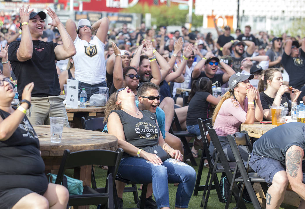 Vegas Golden Knights fans react during a watch party for Game 3 of the Stanley Cup Final between the Golden Knights and the Washington Capitals at the Downtown Las Vegas Events Center on Saturday, ...