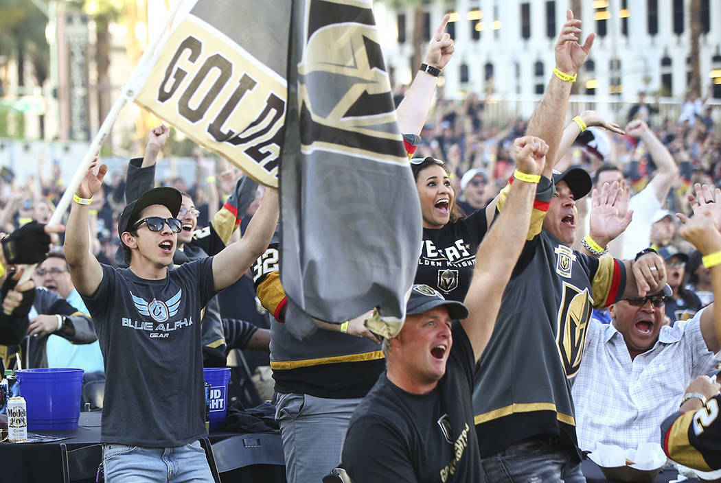 Golden Knights fans celebrate the team's second goal during a watch party for Game 1 of the team's Western Conference Final against the Winnipeg Jets at the Downtown Las Vegas Events Center in Las ...