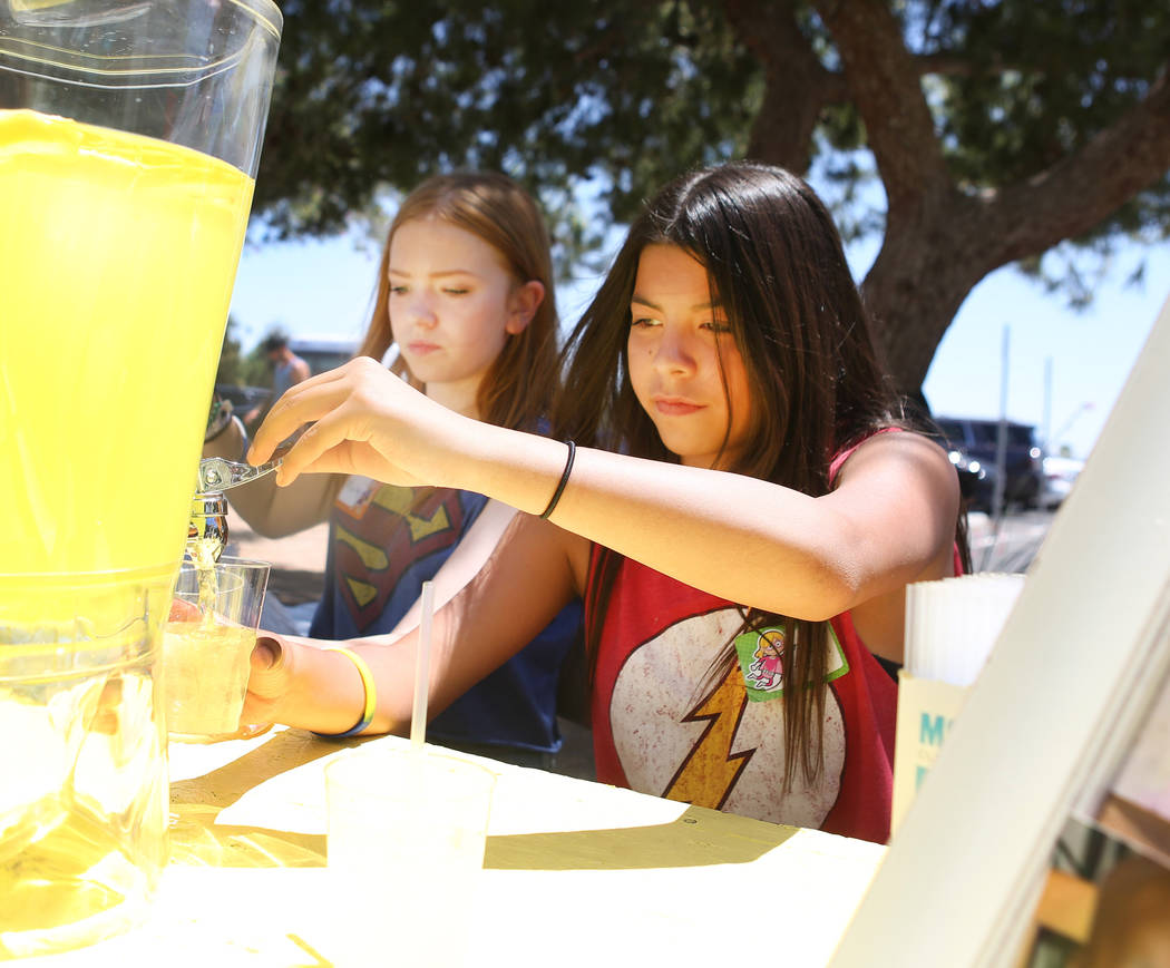 Mallory Poushay, 13, left, and Alyciana Rivas, 13, hand out lemonade during Alex's Lemonade Stand Foundation fundraiser for children's research at Sunset Park in Las Vegas, Sunday, June 4, 2017. ...