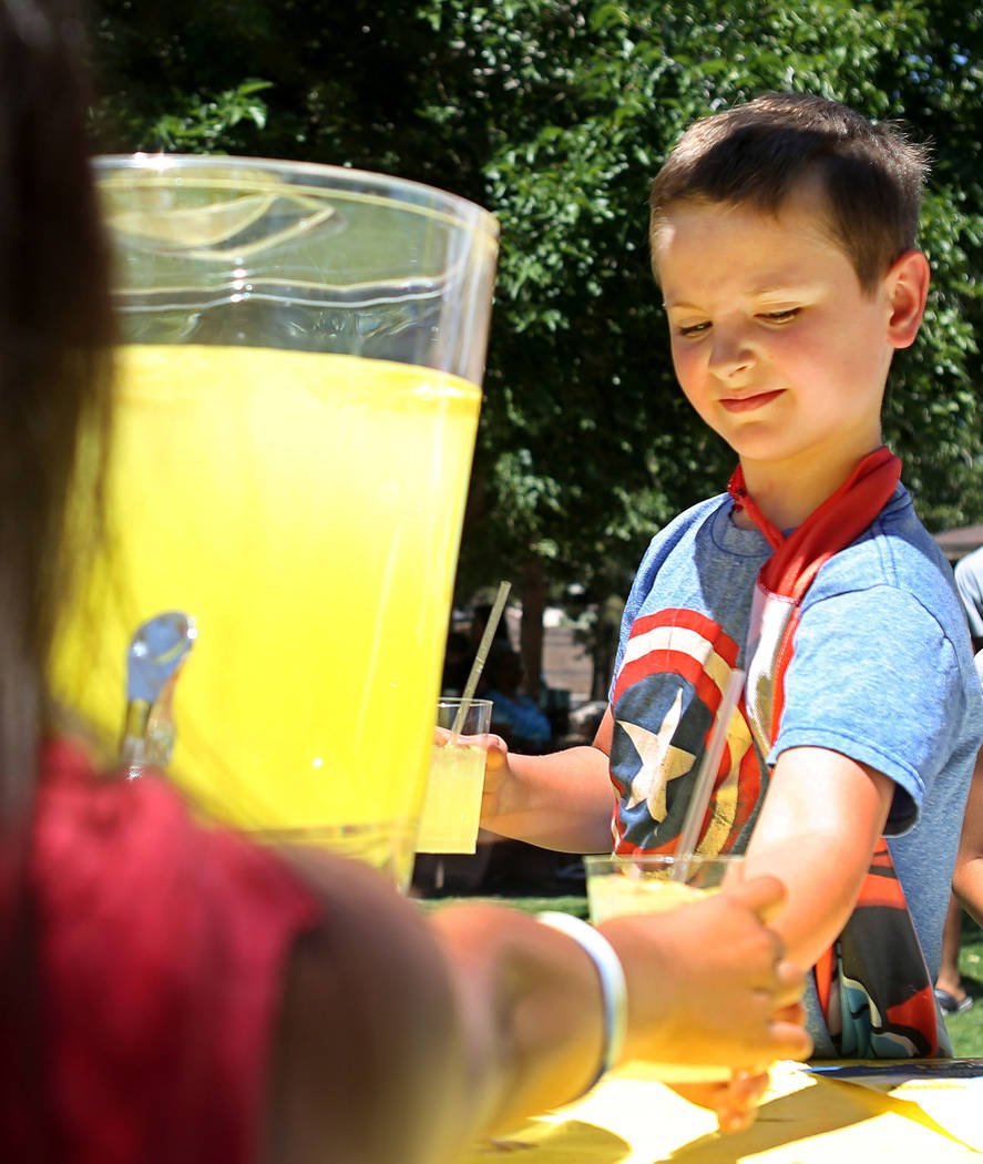 Adam Kemper, 9, works during a fundraiser for Alex's Lemonade Stand Foundation, a national childhood cancer foundation, at Sunset Park in Las Vegas, Sunday, June 4, 2017. (Elizabeth Brumley/Las Ve ...