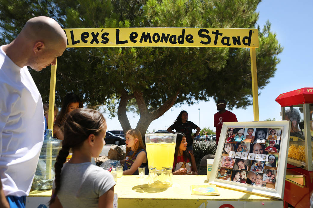 "Drinks and popcorn served at Alex's Lemonade Stand Foundation fundraiser for children's research that is super hero themed as a proclamation that ""we are the heroes!"" at Sunset Park in ..."