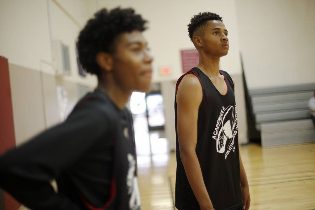 Darwin Page, 15, left, and D'Andre Burnett, wait for their turn during basketball practice for the LV Stars at the Chuck Minker Sports Complex in Las Vegas, Tuesday, May 8, 2018. Rachel Aston Las ...