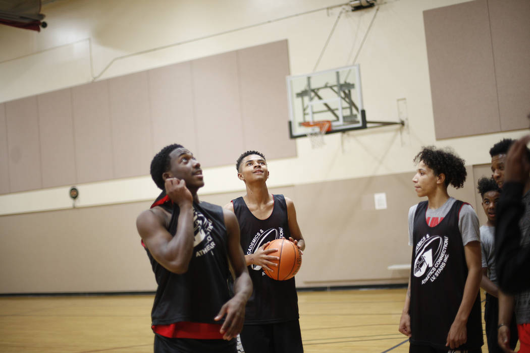 Khalid King, 16, from left, D'Andre Burnett, and Jordan McGriff, 17, wait for their turn during basketball practice for the LV Stars at the Chuck Minker Sports Complex in Las Vegas, Tuesday, May 8 ...