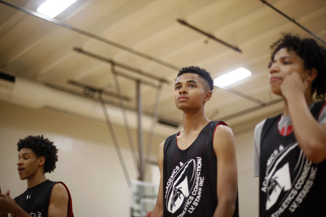 Jordan Carter, 18, from left, D'Andre Burnett, and Jordan McGriff listen to instruction during basketball practice for the LV Stars at the Chuck Minker Sports Complex in Las Vegas, Tuesday, May 8, ...