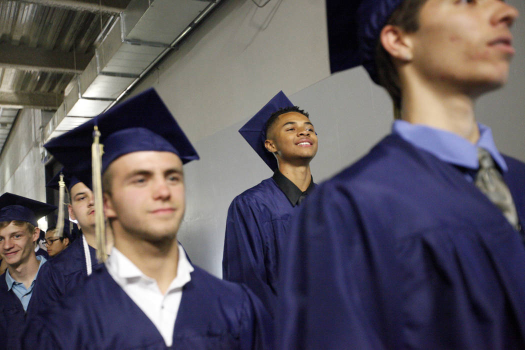 D'Andre Burnett waits in line on graduation day at the Thomas & Mack Center in Las Vegas, Thursday, May 24, 2018. Burnett finished his credits the day before in order to make the deadline of gradu ...