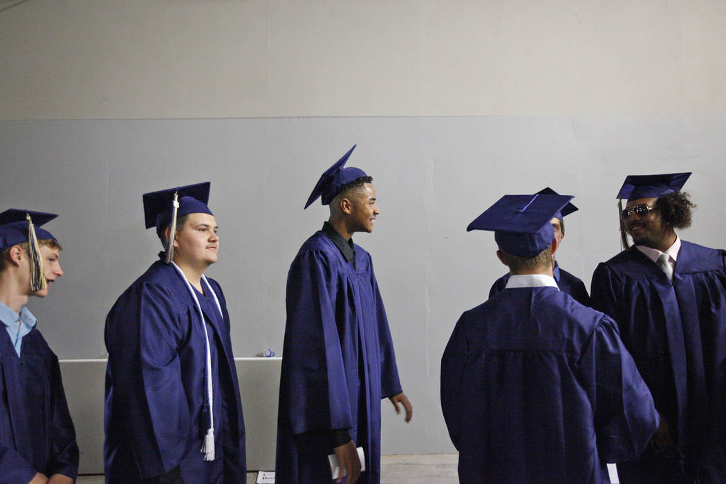 D'Andre Burnett, center, waits in line on graduation day at the Thomas & Mack Center in Las Vegas, Thursday, May 24, 2018. Burnett finished his credits the day before in order to make the dead ...