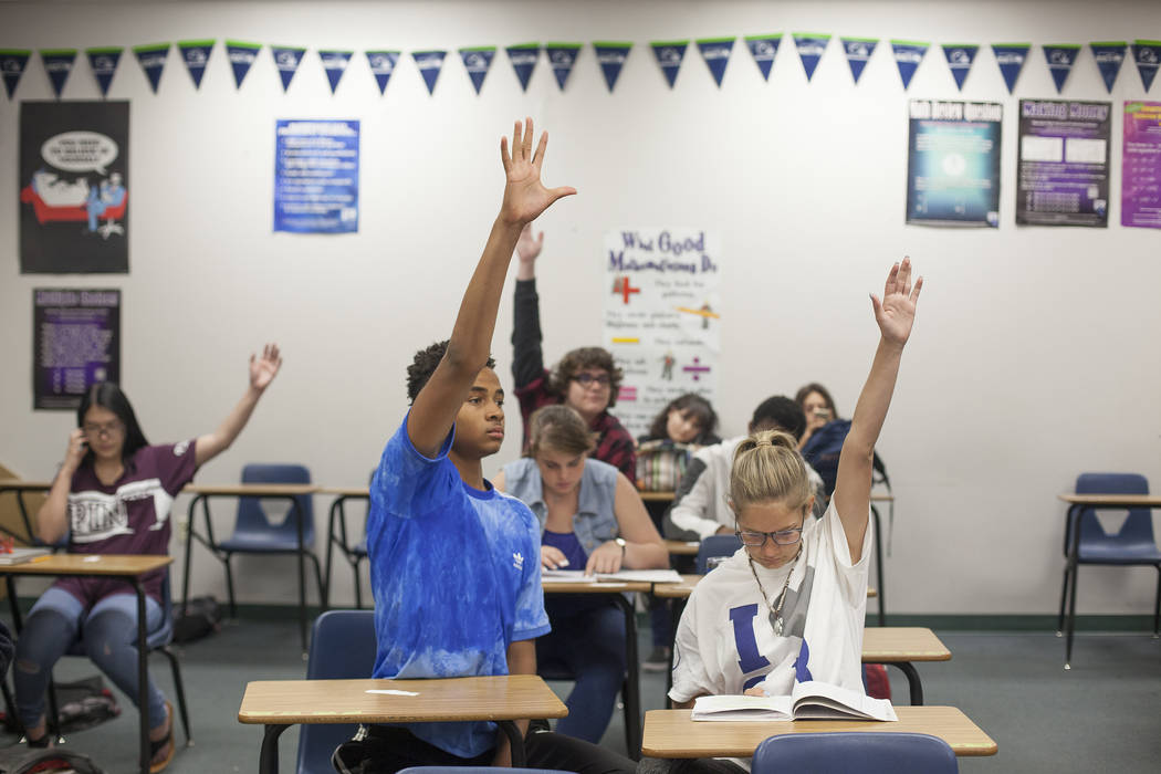 D'Andre Burnett, left, raises his hand to answer a quesion next to Marykate Springer in math class at Shadow Ridge High School in Las Vegas, Wednesday, May 16, 2018. Rachel Aston Las Vegas Review- ...