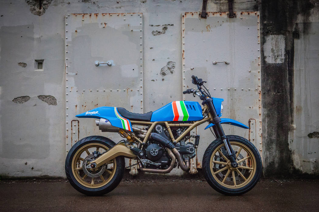 Ducati Designed by tattoo artist Grime, the one-of-a-kind Scrambler Ducati will be auctioned Saturday at the Mecum Las Vegas Motorcycle Auction with the proceeds going to Shriners Hospital for Chi ...