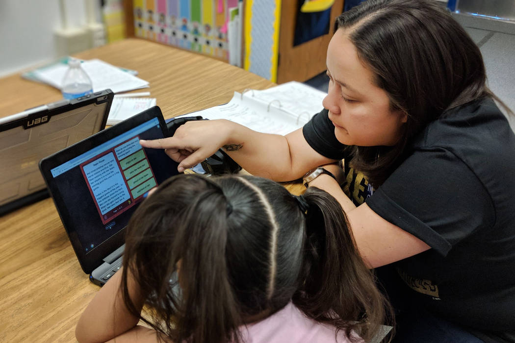 Blanca Martinez, a second-grade teacher at Vail Pittman Elementary School, reviews a comprehension question with one of her students. (Blanca Martinez)