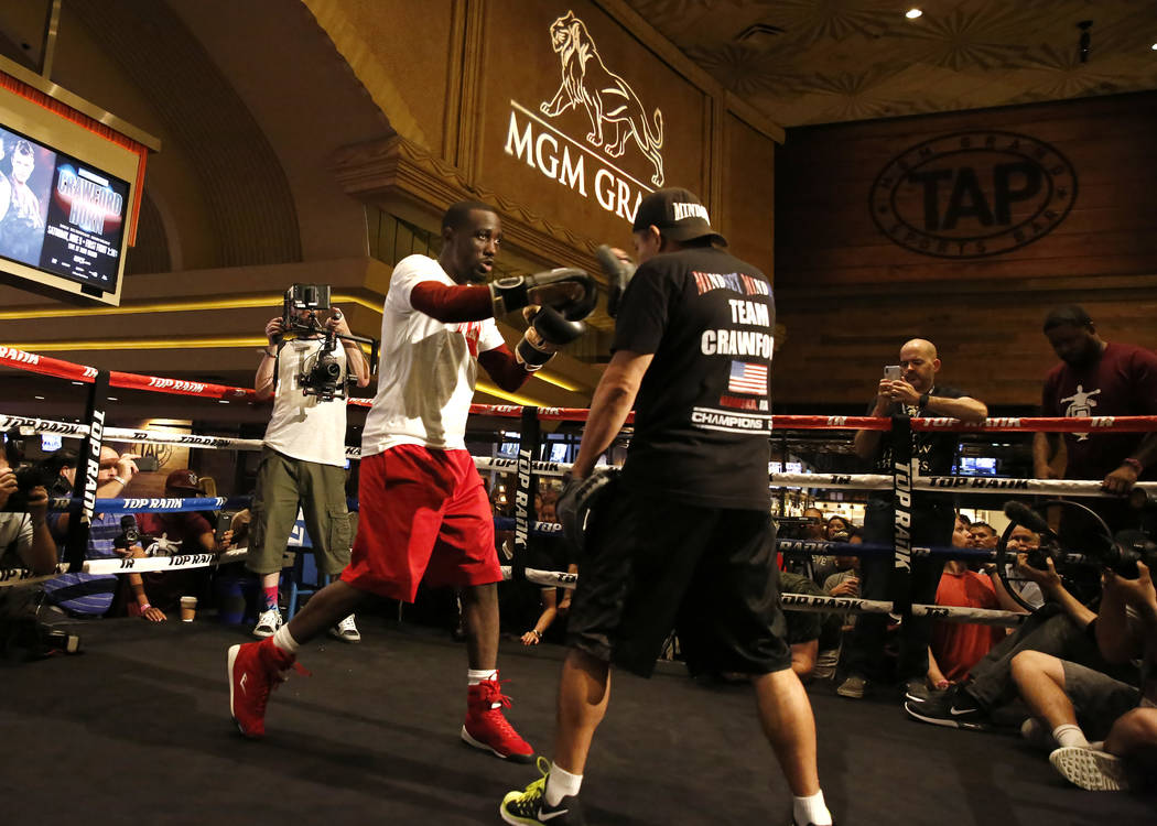 Top Rank takes gamble by putting Crawford-Horn on ESPN+
