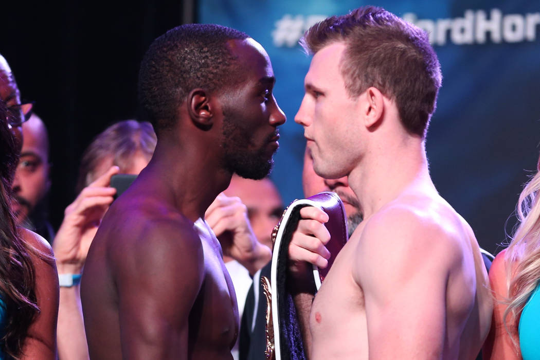 Terence Crawford, left, and Jeff Horn, pose during their official weigh-in at the MGM Grand Garden Arena in Las Vegas, Friday, June 8, 2018. Crawford is challenging WBO welterweight champion Jeff ...