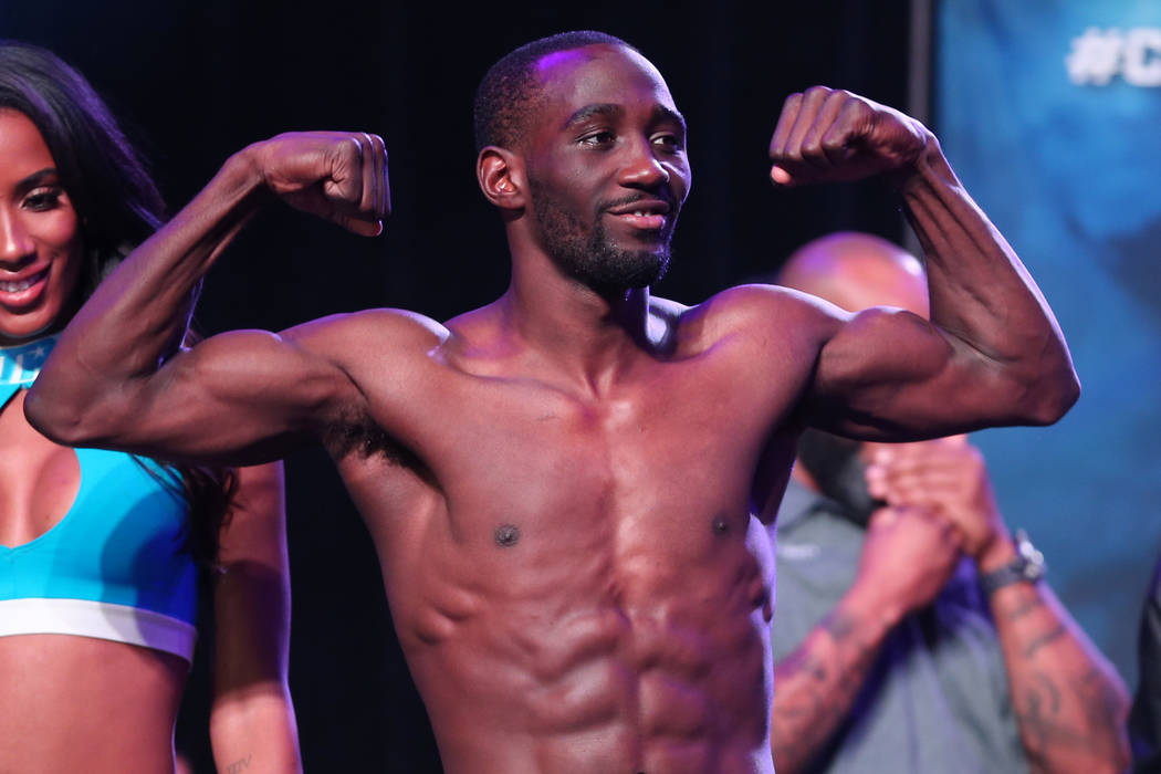 Terence Crawford poses during his official weigh-in at the MGM Grand Garden Arena in Las Vegas, Friday, June 8, 2018. Crawford is challenging WBO welterweight champion Jeff Horn for his title on S ...