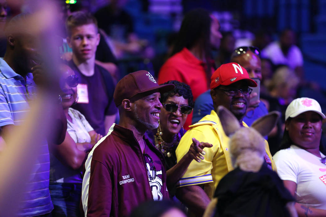 Fans watch the weigh-in event for Terence Crawford and Jeff Horn at the MGM Grand Garden Arena in Las Vegas, Friday, June 8, 2018. Crawford is challenging WBO welterweight champion Jeff Horn for h ...