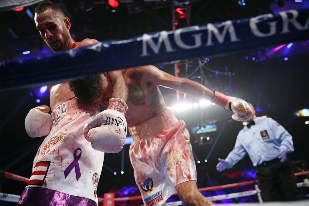 Jose Pedraza holds Antonio Moran in the WBO lightweight Latino Title bout at the MGM Grand Garden Arena in Las Vegas, Saturday, June 9, 2018. Jose Pedraza won by unanimous decision. Erik Verduzco ...