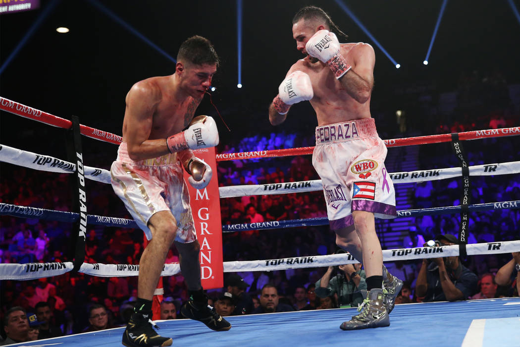 Jose Pedraza, right, connects a punch against Antonio Moran in the WBO lightweight Latino Title bout at the MGM Grand Garden Arena in Las Vegas, Saturday, June 9, 2018. Jose Pedraza won by unanimo ...