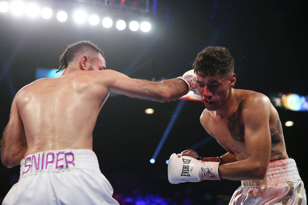 Jose Pedraza, left, connects a punch against Antonio Moran in the WBO lightweight Latino Title bout at the MGM Grand Garden Arena in Las Vegas, Saturday, June 9, 2018. Jose Pedraza won by unanimou ...