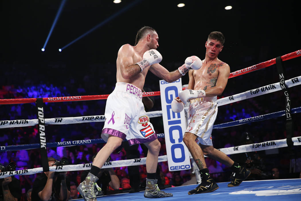 Jose Pedraza, left, battles Antonio Moran in the WBO lightweight Latino Title bout at the MGM Grand Garden Arena in Las Vegas, Saturday, June 9, 2018. Jose Pedraza won by unanimous decision. Erik ...