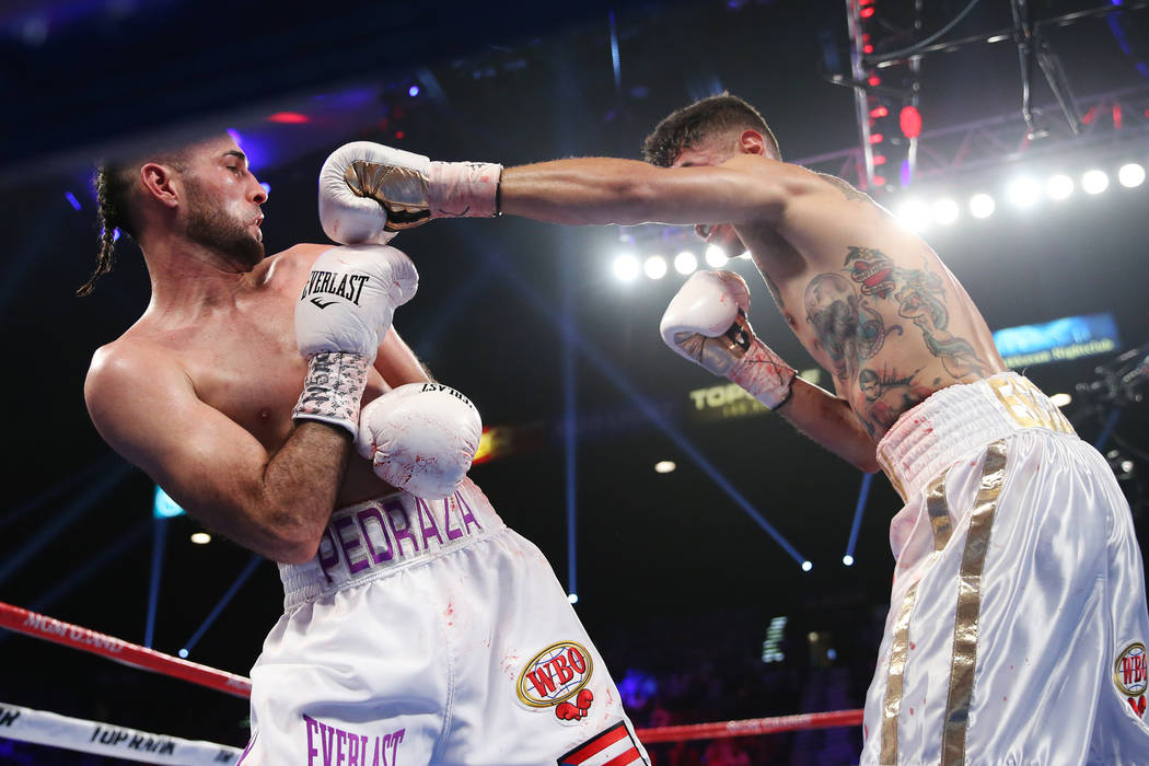 Jose Pedraza, left, moves way from a punch by Antonio Moran in the WBO lightweight Latino Title bout at the MGM Grand Garden Arena in Las Vegas, Saturday, June 9, 2018. Jose Pedraza won by unanimo ...