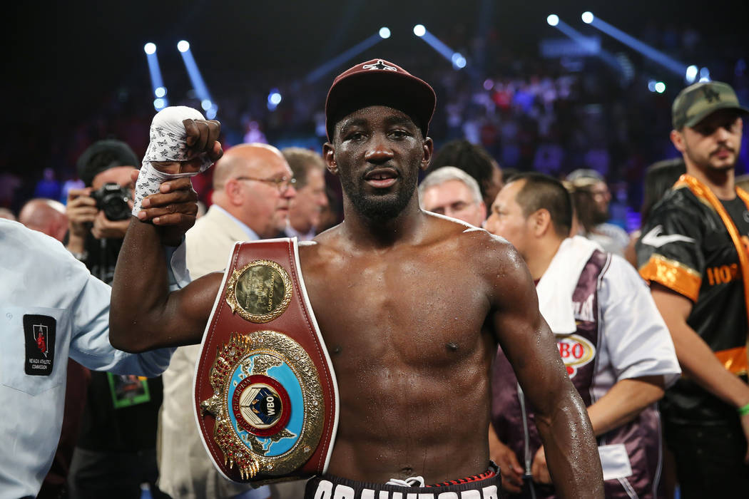 Terence Crawford poses after his technical knockout win against Jeff Horn in the WBO welterweight World Title bout at the MGM Grand Garden Arena in Las Vegas, Saturday, June 9, 2018. Crawford won ...