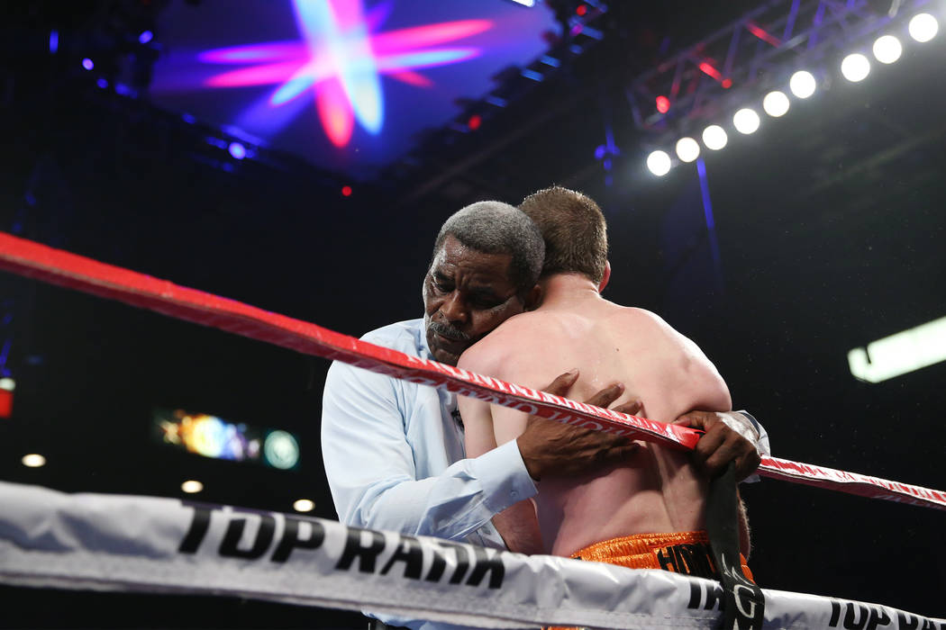 Robert Byrd holds Jeff Horn after stopping the fight against Terence Crawford in the WBO welterweight World Title bout at the MGM Grand Garden Arena in Las Vegas, Saturday, June 9, 2018. Crawford ...