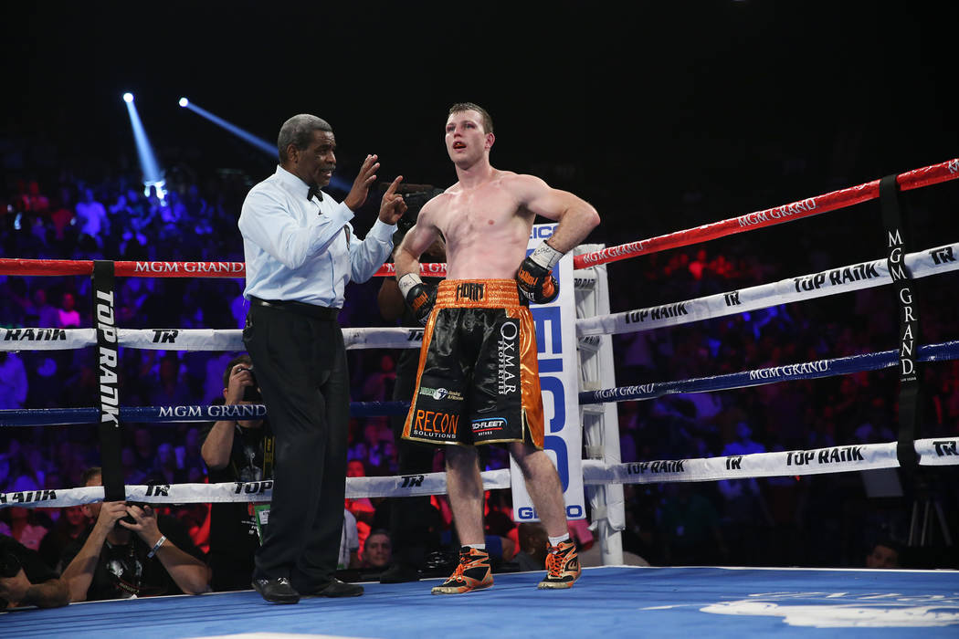 Jeff Horn gets a count after getting knocked down against Terence Crawford in the WBO welterweight World Title bout at the MGM Grand Garden Arena in Las Vegas, Saturday, June 9, 2018. Crawford won ...