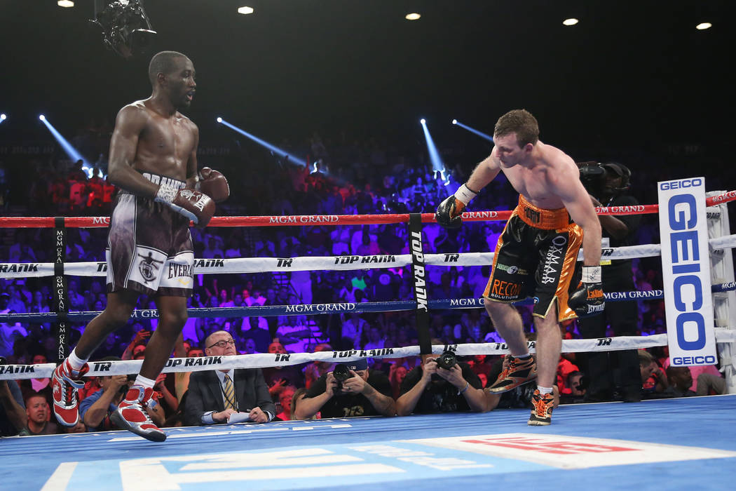 Jeff Horn, right, stumbles against Terence Crawford in the WBO welterweight World Title bout at the MGM Grand Garden Arena in Las Vegas, Saturday, June 9, 2018. Crawford won by technical knockout ...