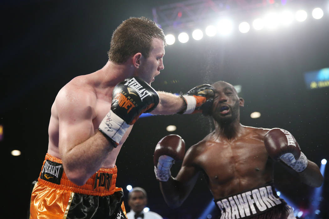 Jeff Horn, left, connects a punch against Terence Crawford in the WBO welterweight World Title bout at the MGM Grand Garden Arena in Las Vegas, Saturday, June 9, 2018. Crawford won by technical kn ...