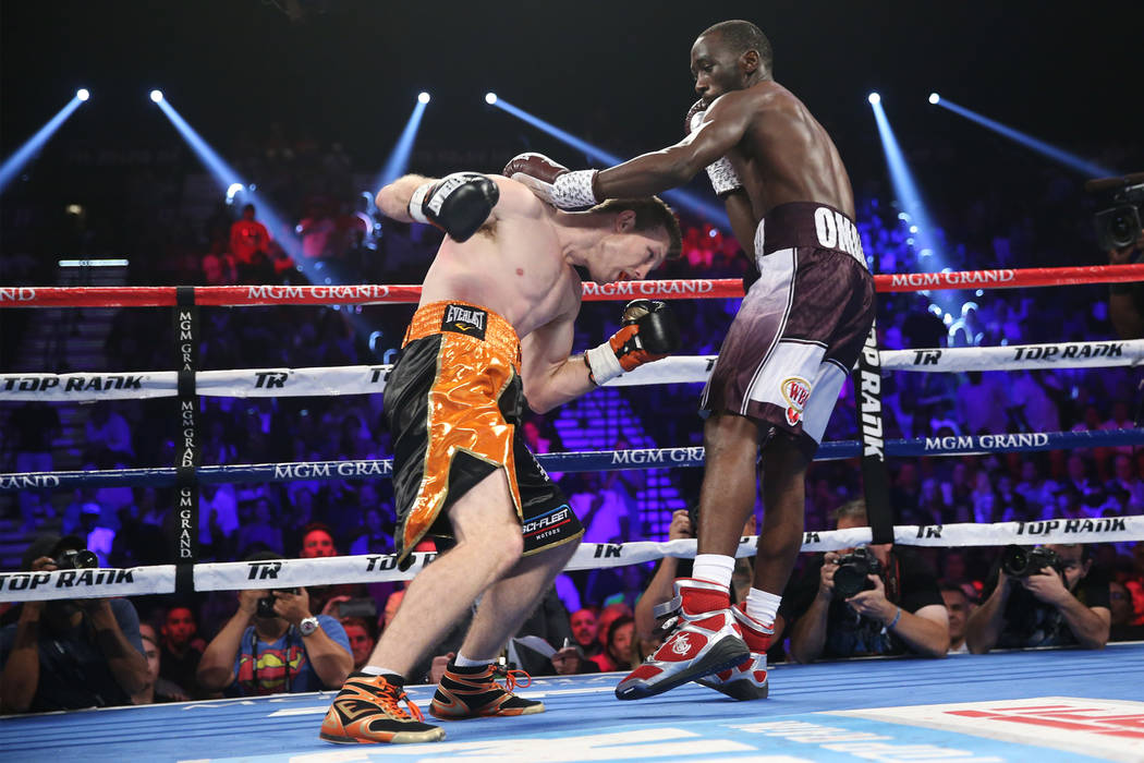 Jeff Horn, left, battles Terence Crawford in the WBO welterweight World Title bout at the MGM Grand Garden Arena in Las Vegas, Saturday, June 9, 2018. Crawford won by technical knockout in the nin ...