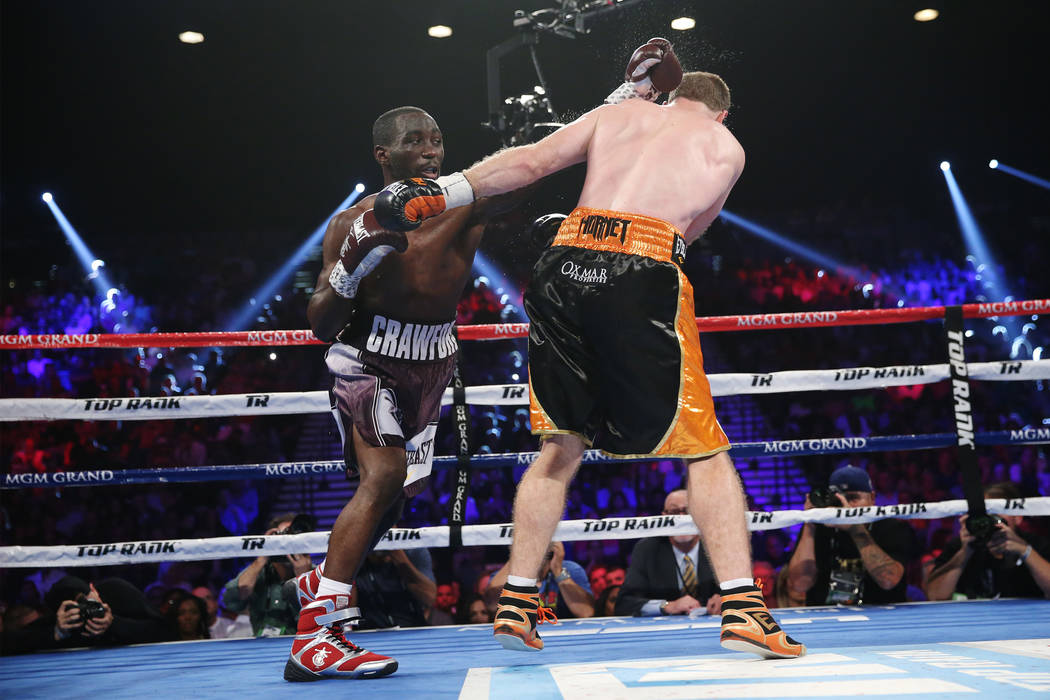 Terence Crawford battles Jeff Horn in the WBO welterweight World Title bout at the MGM Grand Garden Arena in Las Vegas, Saturday, June 9, 2018. Crawford won by technical knockout in the ninth roun ...