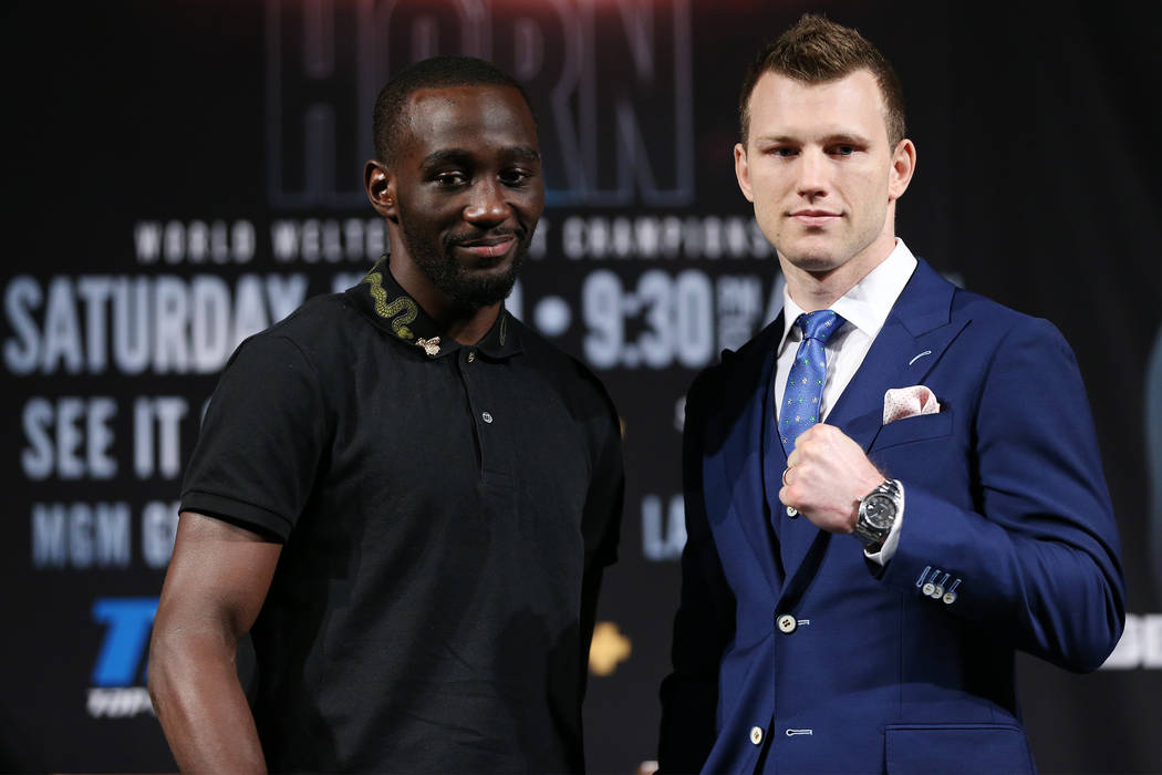Terence Crawford, left, and Jeff Horn, pose during a press conference at the MGM Grand casino-hotel in Las Vegas, Thursday, June 7, 2018. Crawford and Horn will fight Saturday night at the MGM Gra ...