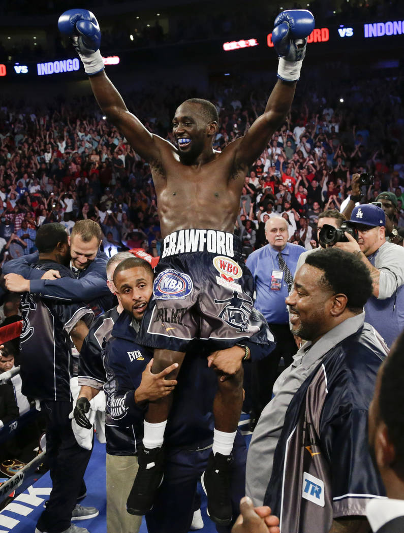 "Terence ""Bud"" Crawford celebrates his victory by knockout over Julius Indongo in the third round of a junior welterweight world title unification bout in Lincoln, Neb., Saturday, Aug. 19, 2017. (A ..."